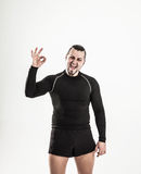Concept of victory in sports-happy bodybuilder rejoice their vic Royalty Free Stock Images