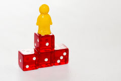 Concept of victory. Yellow figure stands on the pedistal. First place stock photo