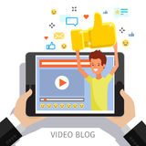 Concept of video blogging. Concept of video blogging, likes and positive feedback. . The guy with golden like is in his video blog on the screen. Flat design Royalty Free Stock Photo
