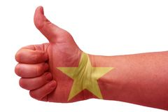 The concept of Vietnam-the hand gives a thumbs up with the flag of Vietnam. The hand and the flag of Vietnam stock photo