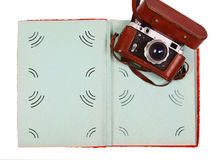Vintage camera and colorful green photo album isolated on white. Concept of a vintage camera and open colorful green photo album isolated on white Stock Photos