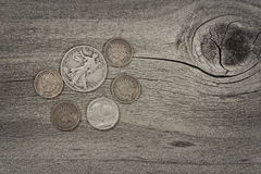 Concept of vintage coins on aged wood Stock Images