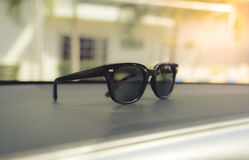 Concept vintage of sunglasses on the console car. Royalty Free Stock Photo
