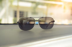 Concept vintage of sunglasses on the console car. Royalty Free Stock Photos
