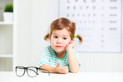 Concept vision testing. child girl with eyeglasses. At the doctor ophthalmologist royalty free stock images
