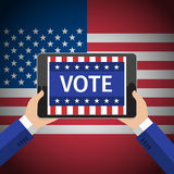 Concept of voting. Man hold tablet with vote on american flag background. Flat design, vector illustration Stock Photo