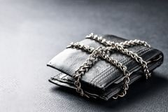 The concept of the wallet is locked with a chain stock photos