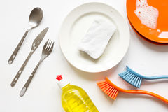 Concept of washing dishes on white background top view Stock Images
