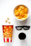 Concept of watching movies with chips top view white background Royalty Free Stock Image