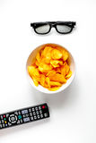 Concept of watching movies with chips top view white background Royalty Free Stock Photography