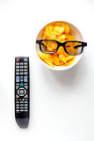 Concept of watching movies with chips top view white background Stock Photos