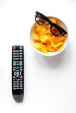 Concept of watching movies with chips top view white background Stock Images