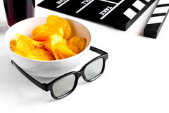 Concept of watching movies with chips white background Royalty Free Stock Images