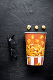 Concept of watching movies with popcorn top view dark background Royalty Free Stock Photos