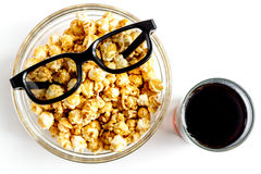 Concept of watching movies with popcorn top view white background Stock Images