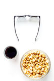 Concept of watching movies with popcorn top view white background Royalty Free Stock Photo