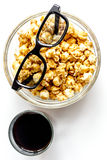 Concept of watching movies with popcorn top view white background Royalty Free Stock Images