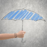 Concept of waterproof by holding a umbrella Stock Image