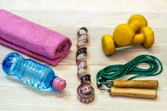 The concept of a way of life. Dumbbells, karemat and rope on the royalty free stock photos