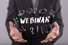 Concept of webinar. Webinar concept above the hands of a man in background royalty free stock image