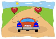 Concept of a wedding honeymoon or valentine day cards. A loving couple rides a car in the summer in the countryside with. The couple leaves on a wedding love Stock Images