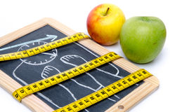 Concept of weight loss, apples and a tape measure Royalty Free Stock Photography