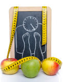 Concept of weight loss, apples and a tape measure Stock Photography