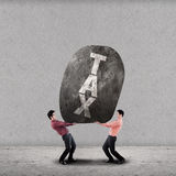 Concept of the weight of the TAX Royalty Free Stock Photo