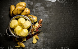 The concept of wet peeled potatoes on a stone background . Free space for text. Stock Photos