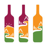 concept of wine bottles with trees and mountains Stock Image