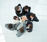 Concept of the winning team .happy business team raising their a Royalty Free Stock Image