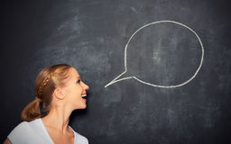 Concept woman said at a blank blackboard Royalty Free Stock Photography