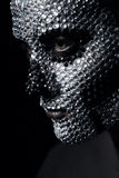Concept woman with silver skull face. In studio Royalty Free Stock Photography
