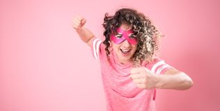 Concept of women, portrait of a woman with a superhero mask royalty free stock photo