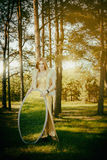 Concept wonderful fairy tale with beautiful girl in country of m Stock Image