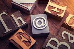 Concept word forming on wooden E-mail symbol. Concept word forming with cube on wooden E-mail symbol Royalty Free Stock Photos