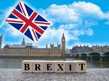 The concept of the words brexit with UK flag. On the background of the Palace of Westminster in London Stock Photos