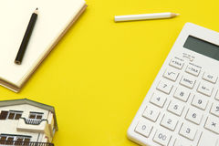The concept of working desk layouts. The background is yellow with a calculator, a pencil Stock Photos