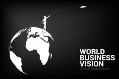 Silhouette of businessman throw origami airplane on world globe. stock photo