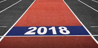 Concept for 2018 Year, Present on Start Line in Running Track at Stock Image
