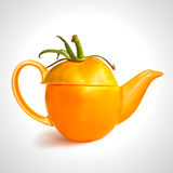 Concept yellow tomato teapot Royalty Free Stock Images