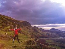 Concept of young lady doing yoga exercises outdoors on the Quiraing in Scotland royalty free stock image