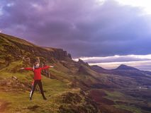 Concept of young lady doing yoga exercises outdoors on the Quiraing in Scotland royalty free stock photos