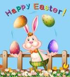 Conception d'affiche avec les oeufs de jonglerie de lapin de Pâques Photographie stock