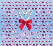 Conception de coeur de canne de sucrerie avec le texte de Joyeux Noël Photo libre de droits