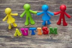 Conception de fond d'enfants de poupée avec le mot d'autisme Image stock