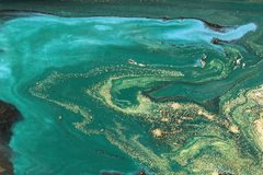 Conception de marbrure de texture d'or Modèle de marbre vert et d'or Art liquide image stock