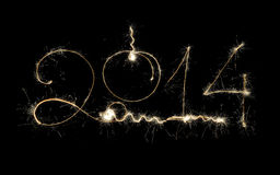 Conception de scintillement de vacances de la nouvelle année 2014 sur le fond noir Photos libres de droits