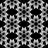 Conception florale blanche sur le fond noir Configuration sans joint Photographie stock