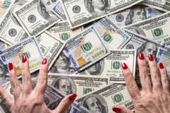 Conception of wealth and rich. Cash money dollar and woman hands. Conception of wealth and rich stock photo